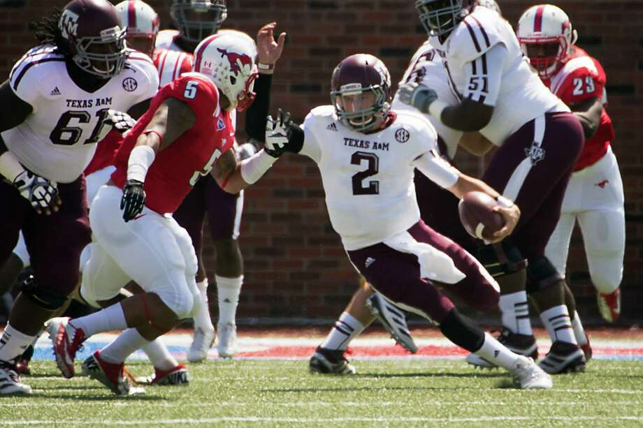 Texas A&M quarterback Johnny Manziel (2) looks for room to run during the first quarter Southern Methodist in an NCAA football game at Ford Stadium, Saturday, Sept. 15, 2012, in Dallas. Photo: Smiley N. Pool, Houston Chronicle / © 2012  Houston Chronicle