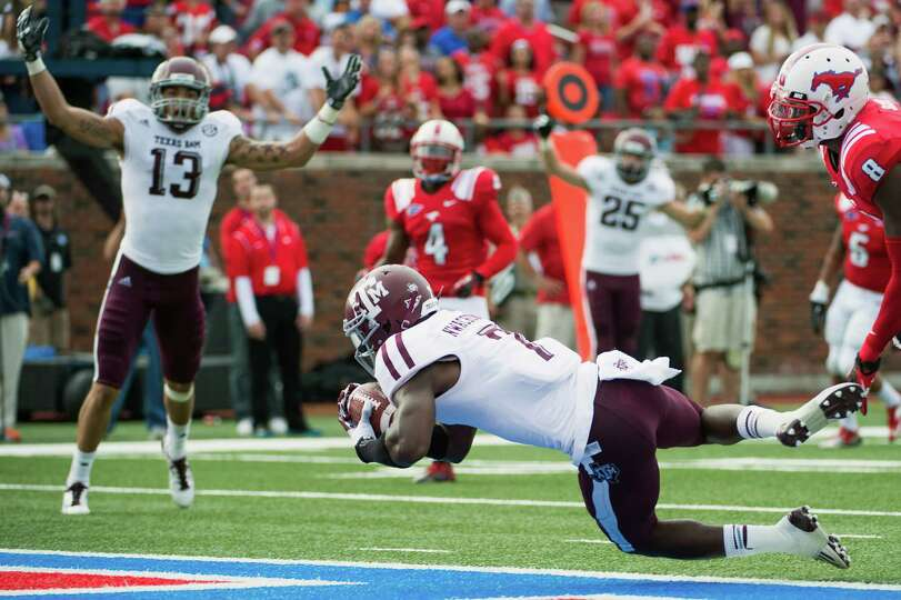 Texas A&M wide receiver Uzoma Nwachukwu crosses the goal line with touchdown reception.