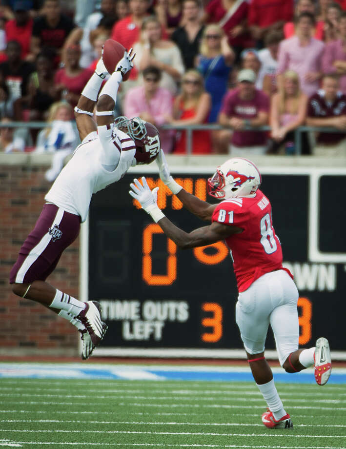 Texas A&M defensive back Tramain Jacobs intercepts a pass intended for Southern Methodist wide receiver Keenan Holman. Photo: Smiley N. Pool, Houston Chronicle / © 2012  Houston Chronicle
