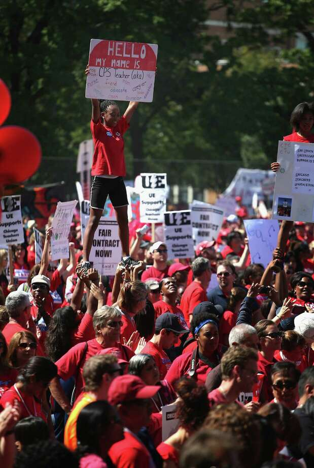 Striking Chicago teachers and supporters rally at Union Park, a mile from where talks continued. Photo: Scott Olson, Getty Images / 2012 Getty Images