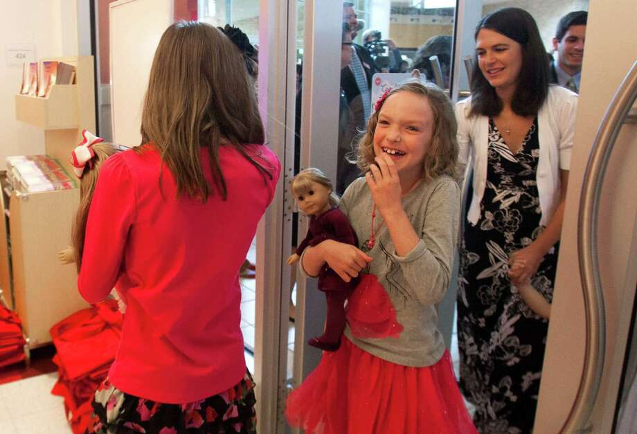 Ellie Wideman, 8, was the first person in line for the opening of the American Girl doll store at Memorial City Mall on Saturday. Store representative had passed out tickets on Friday that designated arrival times Photo: J. Patric Schneider / © 2012 Houston Chronicle