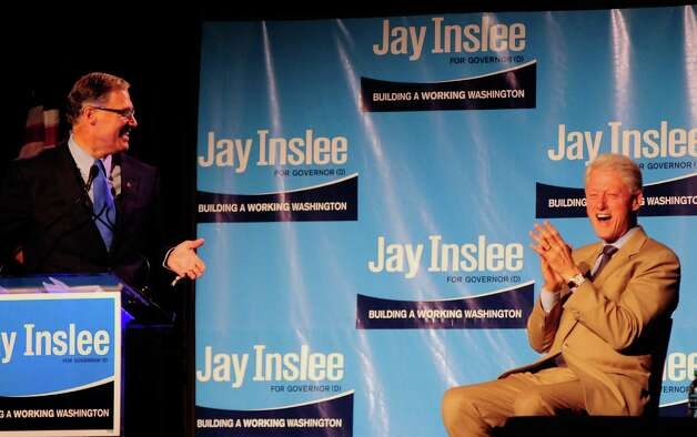 Former President Bill Clinton laughs as Jay Inslee cracks a joke during a campaign fundraiser for Inslee at the Washington State Convention Center on Saturday, September 15, 2012. The event, described by speakers as one of the largest political gatherings Seattle has seen, brought in roughly $750,000 and about 3,000 people. Photo: LINDSEY WASSON / SEATTLEPI.COM