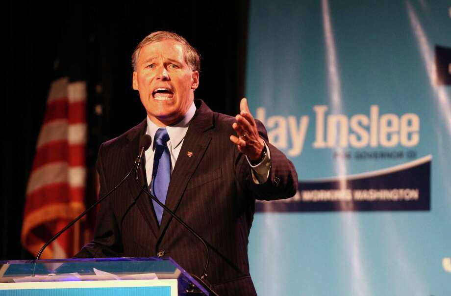 Democratic gubernatorial candidate Jay Inslee speaks passionately to the crowd during a fundraiser for his campaign, which included special guest Bill Clinton at the Washington State Convention Center on Saturday, September 15, 2012. The event, described by speakers as one of the largest political gatherings Seattle has seen, brought in roughly $750,000 and about 3,000 people. Photo: LINDSEY WASSON / SEATTLEPI.COM