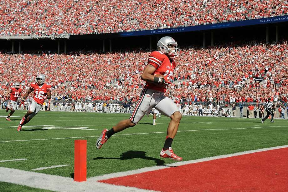Devin Smith of Ohio State, in front of 105,000 fans wearing the same color, scores the game-winning touchdown. Photo: Jamie Sabau, Getty Images
