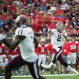 Texas A&M quarterback Johnny Manziel (2) fires a touchdown pass to wide receiver Uzoma Nwachukwu during the second quarter of an NCAA football game against Southern Methodist at Ford Stadium, Saturday, Sept. 15, 2012, in Dallas.