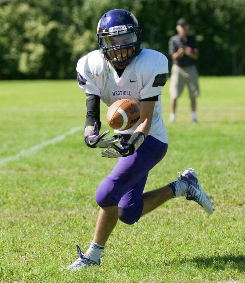 Westhill's Sean Remendino receives as Trinity Catholic High School hosts Westhill in a football game Saturday, Sept. 15, 2012. Trinity won the game, 28-10. Photo: Keelin Daly / Stamford Advocate Freelance