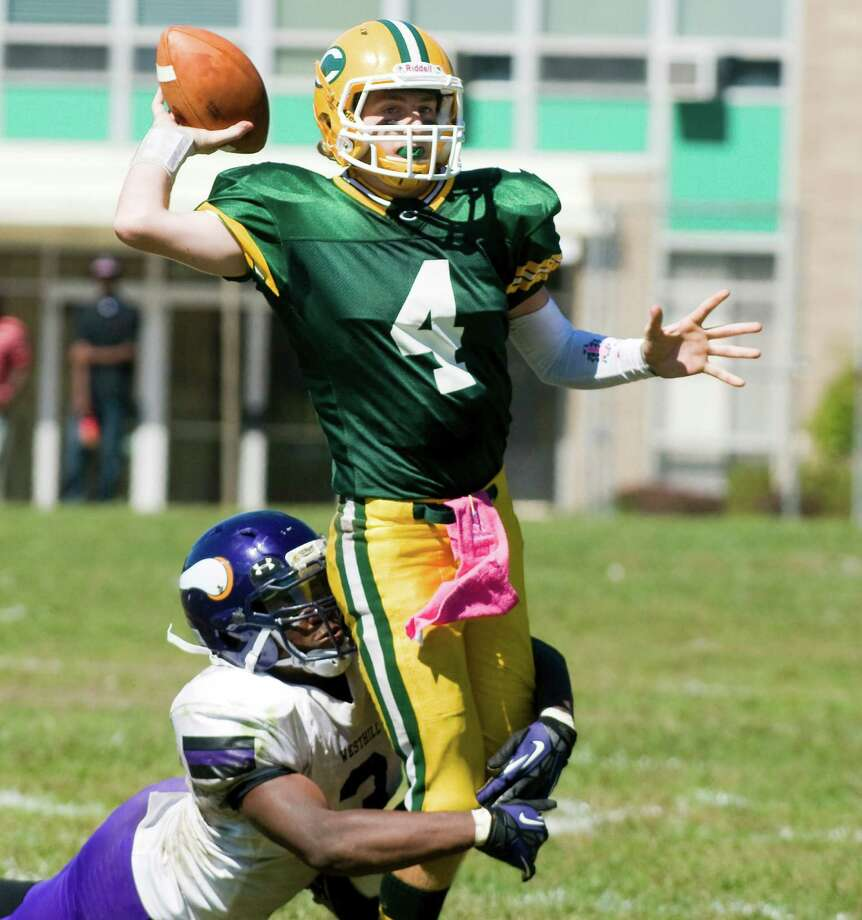 Trinity quarterback Danny O'Leary throws under pressure from Westhill's Moise Francillion as Trinity Catholic High School hosts Westhill in a football game Saturday, Sept. 15, 2012. Trinity won the game, 28-10. Photo: Keelin Daly / Stamford Advocate Freelance