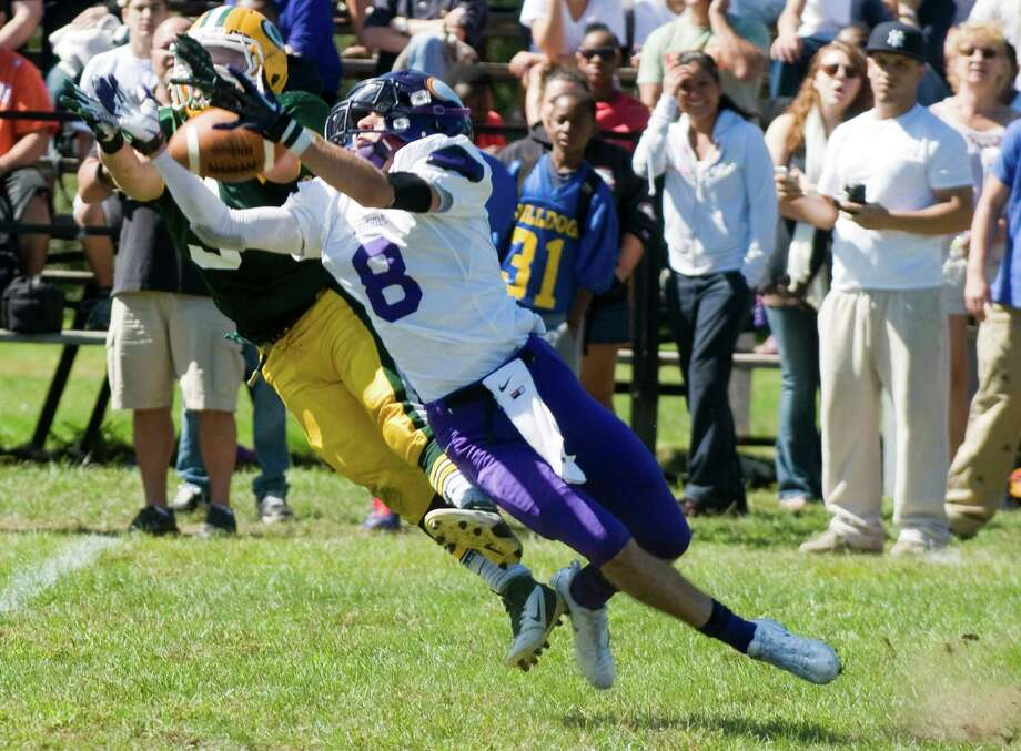 Trinity's Shawn Crowell and Westhill's Dante Farnolgi fight for the ball as Trinity Catholic High School hosts Westhill in a football game Saturday, Sept. 15, 2012. Trinity won the game, 28-10. Photo: Keelin Daly / Stamford Advocate Freelance