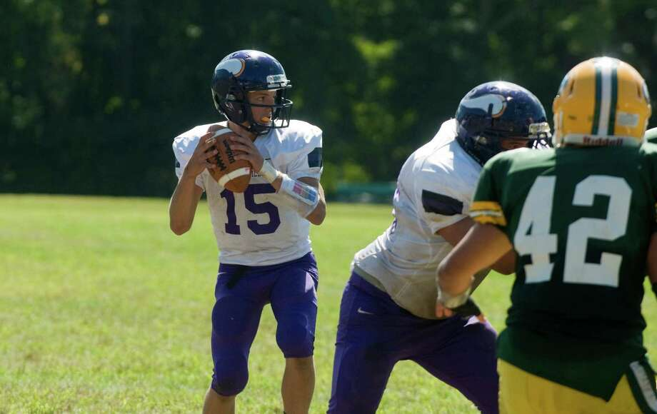 Westhill quarterback Ryan Coppolla in action as Trinity Catholic High School hosts Westhill in a football game Saturday, Sept. 15, 2012. Trinity won the game, 28-10. Photo: Keelin Daly / Stamford Advocate Freelance