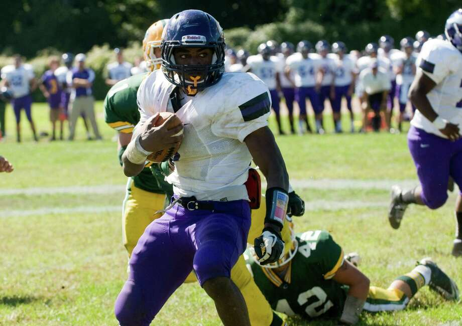 Westhill's Davell Cotterell in action as Trinity Catholic High School hosts Westhill in a football game Saturday, Sept. 15, 2012. Trinity won the game, 28-10. Photo: Keelin Daly / Stamford Advocate Freelance