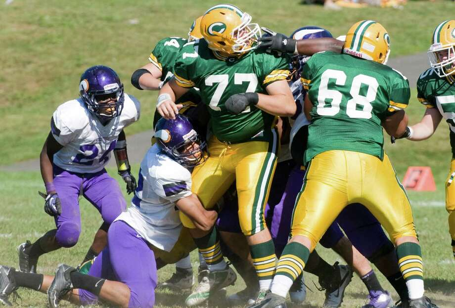Trinity's Matt Pascale holds his own in the action as Trinity Catholic High School hosts Westhill in a football game Saturday, Sept. 15, 2012. Trinity won the game, 28-10. Photo: Keelin Daly / Stamford Advocate Freelance