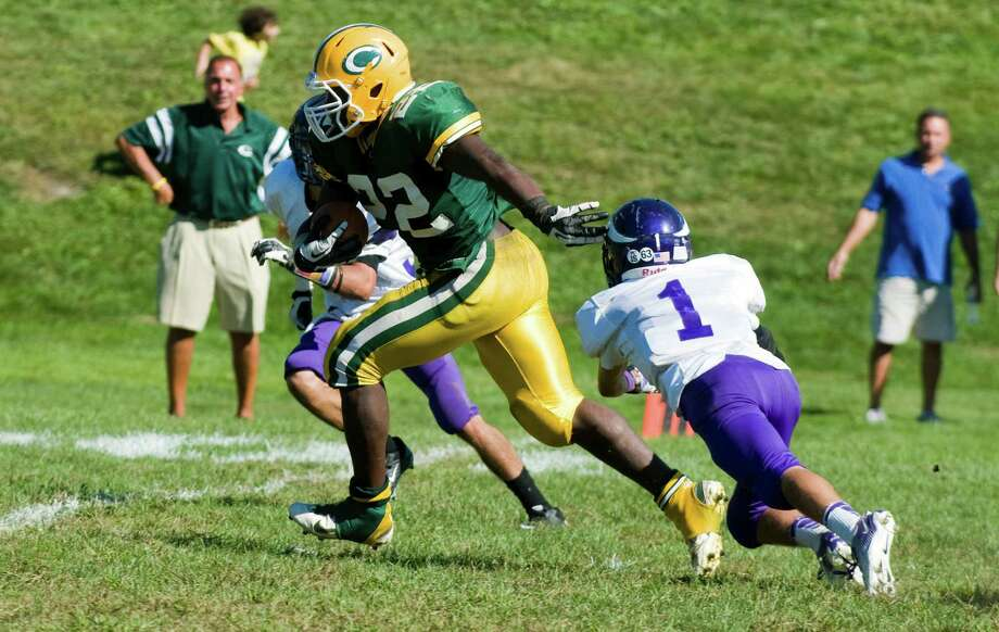 Trinity's Shaquan Howsie heads for the endzone as Trinity Catholic High School hosts Westhill in a football game Saturday, Sept. 15, 2012. Trinity won the game, 28-10. Photo: Keelin Daly / Stamford Advocate Freelance