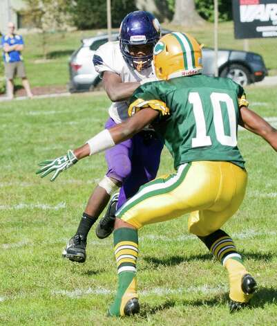 Westhill's Davell Cotterell runs for Trinity's Chris Durant as Trinity Catholic High School hosts Westhill in a football game Saturday, Sept. 15, 2012. Trinity won the game, 28-10. Photo: Keelin Daly / Stamford Advocate Freelance