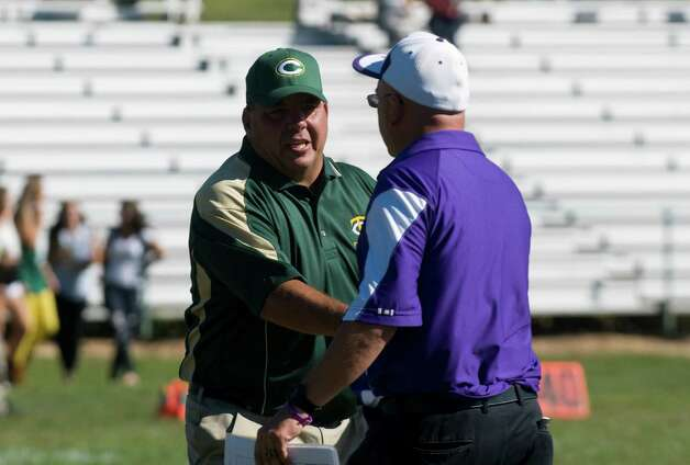 Trinity and Westhill Coaches Pete Stokes, left, and Frank Marcucio shake hands after Trinity Catholic High School hosts Westhill in a football game Saturday, Sept. 15, 2012. Trinity won the game, 28-10. Photo: Keelin Daly / Stamford Advocate Freelance