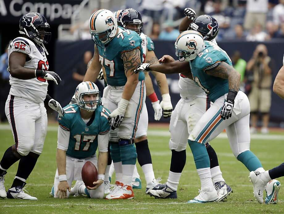 Miami Dolphins' Ryan Tannehill (17) reacts after he was sacked during play against the Houston Texas in the fourth quarter of an NFL football game Sunday, Sept. 9, 2012, in Houston. The Texans won 30-10. (AP Photo/Eric Gay) Photo: Eric Gay, Associated Press
