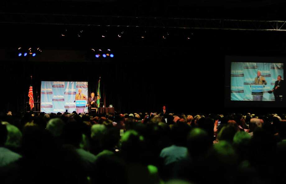 Thousands of supporters watch as former President Bill Clinton speaks at a campaign fundraiser for Democratic gubernatorial candidate Jay Inslee at the Washington State Convention Center on Saturday, September 15, 2012. The event, which featured former President Bill Clinton, was described by speakers as one of the largest political gatherings Seattle has seen, brought in roughly $750,000 and about 3,000 people. Photo: LINDSEY WASSON / SEATTLEPI.COM