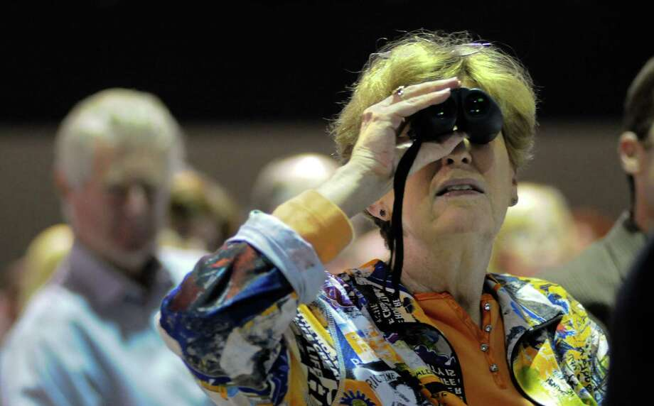 Nancy Katims tries to get a better view of speakers with a pair of binoculars during a campaign fundraiser for Democratic gubernatorial candidate Jay Inslee at the Washington State Convention Center on Saturday, September 15, 2012. The event, which featured former President Bill Clinton, was described by speakers as one of the largest political gatherings Seattle has seen, brought in roughly $750,000 and about 3,000 people. Photo: LINDSEY WASSON / SEATTLEPI.COM