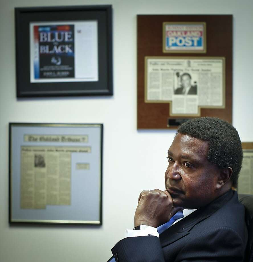 Civil rights attorney John Burris is seen in his law office conference room on Monday, Sep. 10, 2012 in Oakland, Calif.  News clippings about Burris and his cases line the walls of his offices. Photo: Russell Yip, The Chronicle