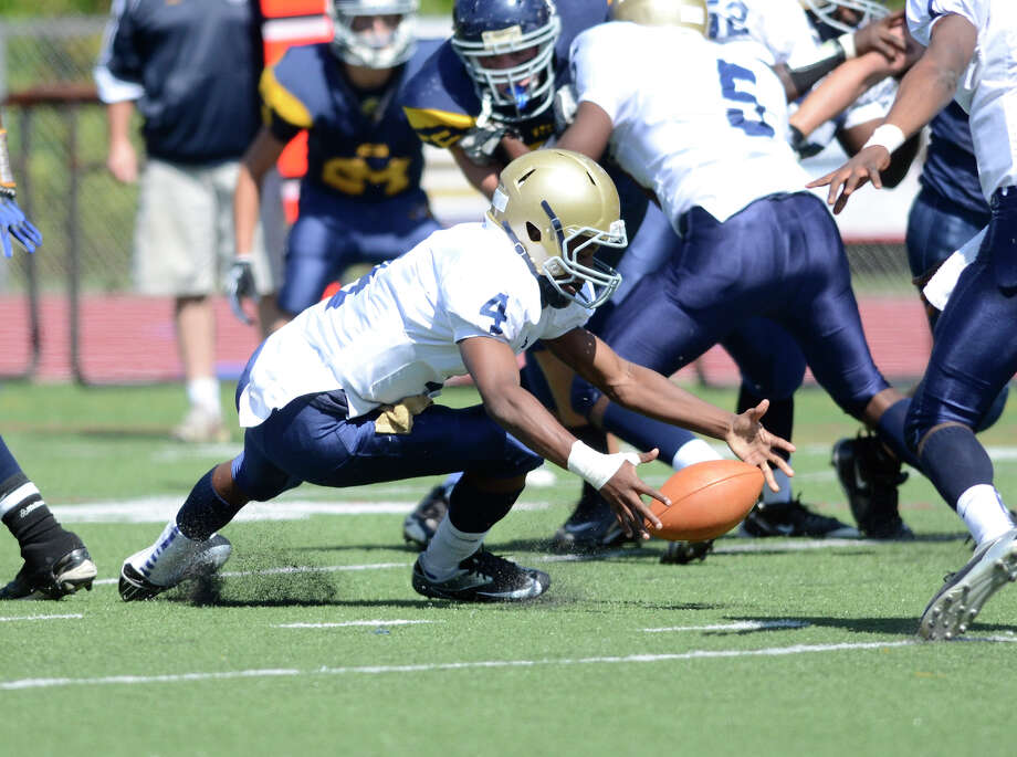Notre Dame's Tajik Bagley reaches for the ball as Weston High School hosts Notre Dame of Fairfield High School in varsity football in Weston, CT on Sept. 15, 2012. Photo: Shelley Cryan / Shelley Cryan freelance; CT Post freelance