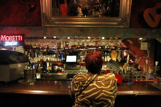 Above: Marilyn Pittman orders a drink at the bar of the Purple Onion, where Woody Allen, Mort Sahl, the Smothers Brothers and others got their start. Photo: Carlos Avila Gonzalez, The Chronicle
