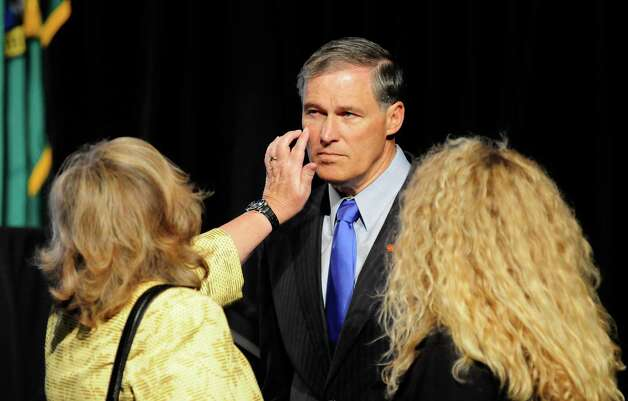 Jay Inslee's wife, Trudi Inslee, brushes something off of his face as he prepares a few hours before a campaign fundraiser for him at the Washington State Convention Center on Saturday, September 15, 2012. The event, which featured former President Bill Clinton, was described by speakers as one of the largest political gatherings Seattle has seen, brought in roughly $750,000 and about 3,000 people. Photo: LINDSEY WASSON / SEATTLEPI.COM