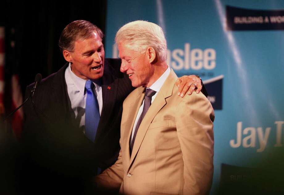 Democratic gubernatorial candidate Jay Inslee shakes hands with former President Bill Clinton during a campaign fundraiser at the Washington State Convention Center on Saturday, September 15, 2012. The event, which featured former President Bill Clinton, was described by speakers as one of the largest political gatherings Seattle has seen, brought in roughly $750,000 and about 3,000 people. Photo: LINDSEY WASSON / SEATTLEPI.COM