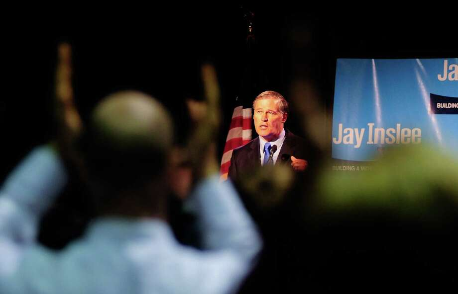 People stand on their feet and clap as  Democratic gubernatorial candidate Jay Inslee speaks to the crowd at the Washington State Convention Center on Saturday, September 15, 2012. The event, which featured former President Bill Clinton, was described by speakers as one of the largest political gatherings Seattle has seen, brought in roughly $750,000 and about 3,000 people. Photo: LINDSEY WASSON / SEATTLEPI.COM