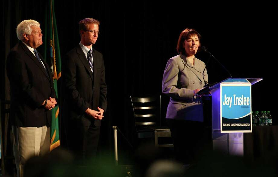 Democratic House of Representatives candidate Suzan DelBene speaks as Representative Jim McDermott and Senator Derek Kilmer look on during a campaign fundraiser for Democratic gubernatorial candidate Jay Inslee at the Washington State Convention Center on Saturday, September 15, 2012. The event, which featured former President Bill Clinton, was described by speakers as one of the largest political gatherings Seattle has seen, brought in roughly $750,000 and about 3,000 people. Photo: LINDSEY WASSON / SEATTLEPI.COM
