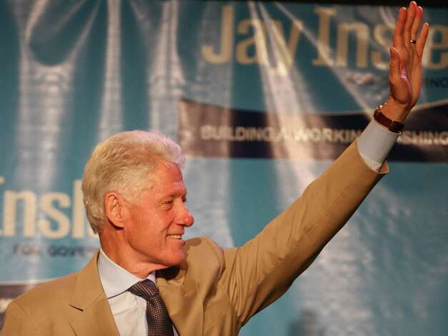 Former president Bill Clinton waves to the crowd as he steps onto the stage during a campaign fundraiser for Democratic gubernatorial candidate Jay Inslee at the Washington State Convention Center on Saturday, September 15, 2012. The event, which featured former President Bill Clinton as a speaker, was described by speakers as one of the largest political gatherings Seattle has seen, brought in roughly $750,000 and about 3,000 people. Photo: LINDSEY WASSON / SEATTLEPI.COM