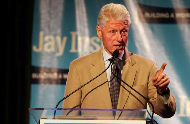 Former President Bill Clinton speaks during a campaign fundraiser for Democratic gubernatorial candidate Jay Inslee at the Washington State Convention Center on Saturday, September 15, 2012. The event, which featured former President Bill Clinton, was described by speakers as one of the largest political gatherings Seattle has seen, brought in roughly $750,000 and about 3,000 people. Photo: LINDSEY WASSON / SEATTLEPI.COM