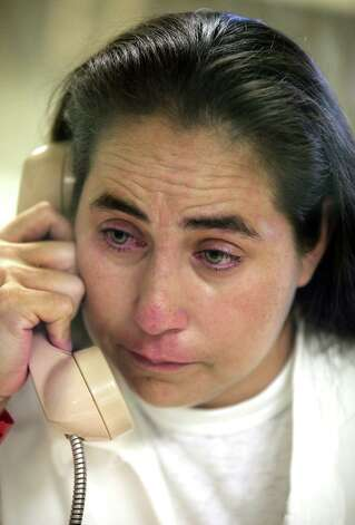 A tearful Anna Vasquez, 37, who was accused in 1994 of aggravated sexual assault of a child, speaks on a phone during a prison interview on Sept, 4, 2012. She is incarcerated at the Murray Unit, in Gatesville, TX. Photo: BOB OWEN, San Antonio Express-News / © 2012 San Antonio Express-News