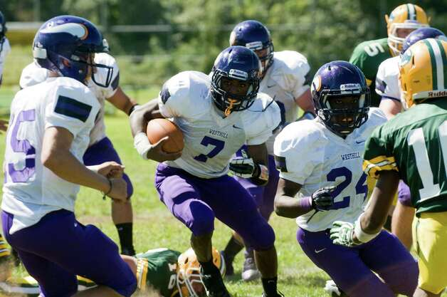 Westhill's Davell Cotterell finds a break in the line as Trinity Catholic High School hosts Westhill in a football game Saturday, Sept. 15, 2012. Trinity won the game, 28-10. Photo: Keelin Daly