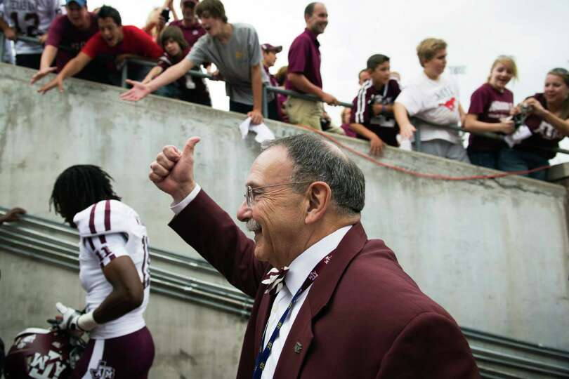 Texas A&M president R. Bowen Loftin celebrates with fans following the Aggies 48-3 victory over Sout