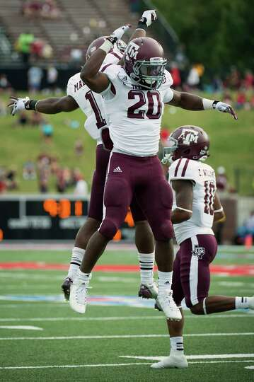 Texas A&M running back Trey Williams (20) celebrates with Ben Malena (1) after scoring on a touchdow