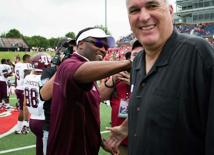 Texas A&M head coach Kevin Sumlin, left, shakes hands with Southern Methodist head coach June Jones