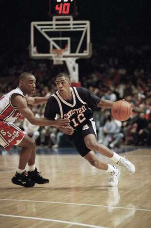 University of Connecticut Huskies Kevin Ollie, right, drives around St. John's Redmen David Cain during first half Big East action at Madison Square Garden, Jan. 30, 1993 in New York. Photo: Mike Albans,  (AP Photo/Mike Albans) / AP1993 Associated Press