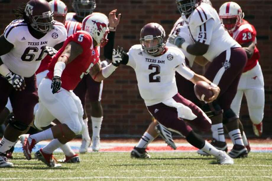 Texas A&M quarterback Johnny Manziel (2) looks for room to run during the first quarter Southern Methodist in an NCAA football game at Ford Stadium, Saturday, Sept. 15, 2012, in Dallas. ( Smiley N. Pool / Houston Chronicle ) (Houston Chronicle)