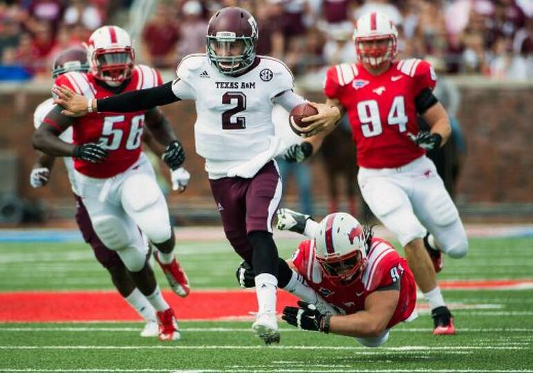 Texas A&M quarterback Johnny Manziel (2) breaks free from Southern Methodist defensive tackle Aaron