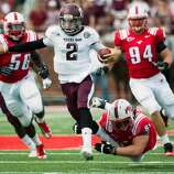 Texas A&M quarterback Johnny Manziel (2) breaks free from Southern Methodist defensive tackle Aaron Davis (93) on a 48-yard touchdown run during the second quarter of an NCAA football game at Ford Stadium, Saturday, Sept. 15, 2012, in Dallas. ( Smiley N. Pool / Houston Chronicle ) (Houston Chronicle)