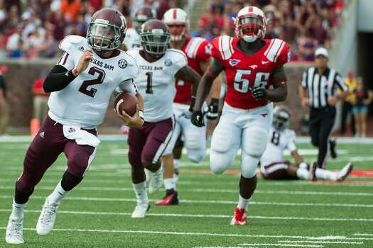 Texas A&M quarterback Johnny Manziel (2) breaks free from the Southern Methodist defense on a 48-yard touchdown run during the second quarter of an NCAA football game at Ford Stadium, Saturday, Sept. 15, 2012, in Dallas. ( Smiley N. Pool / Houston Chronicle ) (Houston Chronicle)