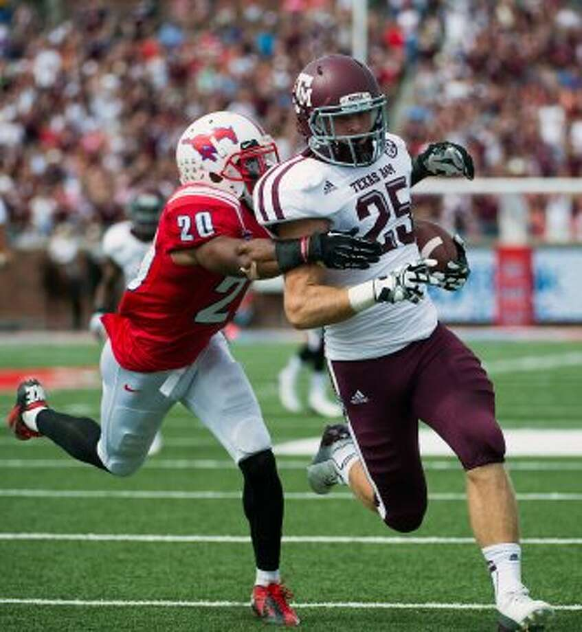 Texas A&M wide receiver Ryan Swope gets past  Southern Methodist defensive back Ryan Smith (20) to score on a touchdown reception during the second quarter of an NCAA football game at Ford Stadium, Saturday, Sept. 15, 2012, in Dallas. ( Smiley N. Pool / Houston Chronicle ) (Houston Chronicle)