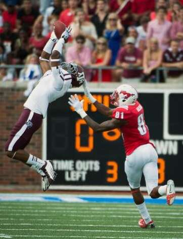 Texas A&M defensive back Tramain Jacobs (7) intercepts a pass intended for Southern Methodist wide receiver Keenan Holman (81) during the second quarter of an NCAA football game at Ford Stadium, Saturday, Sept. 15, 2012, in Dallas. ( Smiley N. Pool / Houston Chronicle ) (Houston Chronicle)