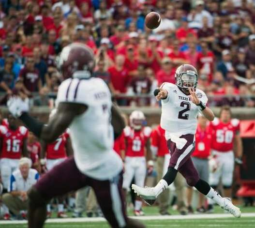 Texas A&M quarterback Johnny Manziel (2) fires a touchdown pass to wide receiver Uzoma Nwachukwu during the second quarter of an NCAA football game against Southern Methodist at Ford Stadium, Saturday, Sept. 15, 2012, in Dallas. ( Smiley N. Pool / Houston Chronicle ) (Houston Chronicle)