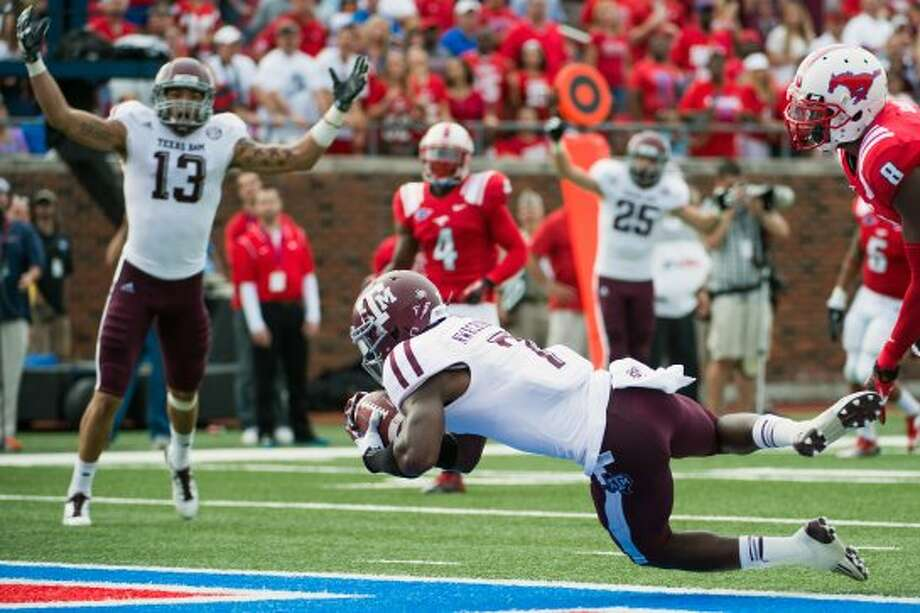 Texas A&M wide receiver Uzoma Nwachukwu (7) crosses the goal line with touchdown reception against Southern Methodist during the second quarter of an NCAA football game at Ford Stadium, Saturday, Sept. 15, 2012, in Dallas. ( Smiley N. Pool / Houston Chronicle ) (Houston Chronicle)