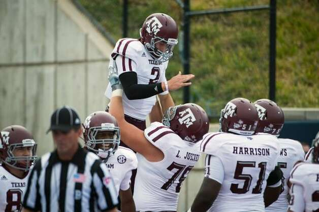 Johnny Manziel directed his first college victory when Texas A&M rolled over SMU 48-3 on Sept. 15, 2012. Manziel ran for 124 yards and two touchdowns and passed for 294 yards and four touchdowns.