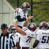 Texas A&M quarterback Johnny Manziel (2) is lifted by offensive linesman Luke Joeckel (76) in celebration of a touchdown run during the second half of an NCAA football game against Southern Methodist at Ford Stadium, Saturday, Sept. 15, 2012, in Dallas.  Texas A&M won the game 48-3.( Smiley N. Pool / Houston Chronicle ) (Houston Chronicle)