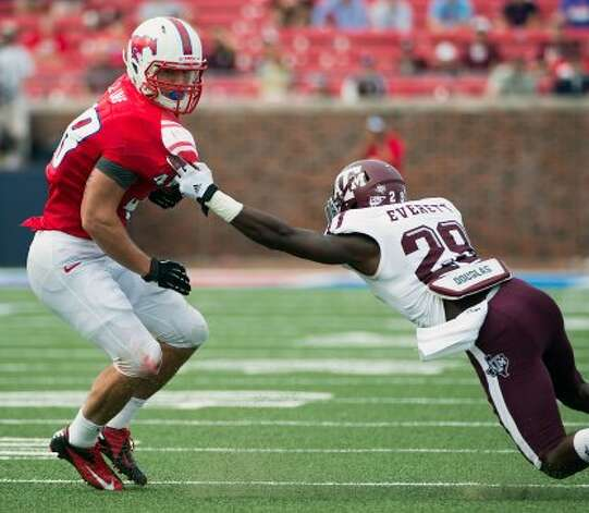 Southern Methodist running back Zach Line (48) is tackled by Texas A&M defensive back Deshazor Everett (29) during the second half of an NCAA football game at Ford Stadium, Saturday, Sept. 15, 2012, in Dallas.  Texas A&M won the game 48-3.( Smiley N. Pool / Houston Chronicle ) (Houston Chronicle)