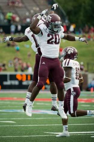 Texas A&M running back Trey Williams (20) celebrates with Ben Malena (1) after scoring on a touchdown run against Southern Methodist during the second half of an NCAA football game at Ford Stadium, Saturday, Sept. 15, 2012, in Dallas.  Texas A&M won the game 48-3.( Smiley N. Pool / Houston Chronicle ) (Houston Chronicle)