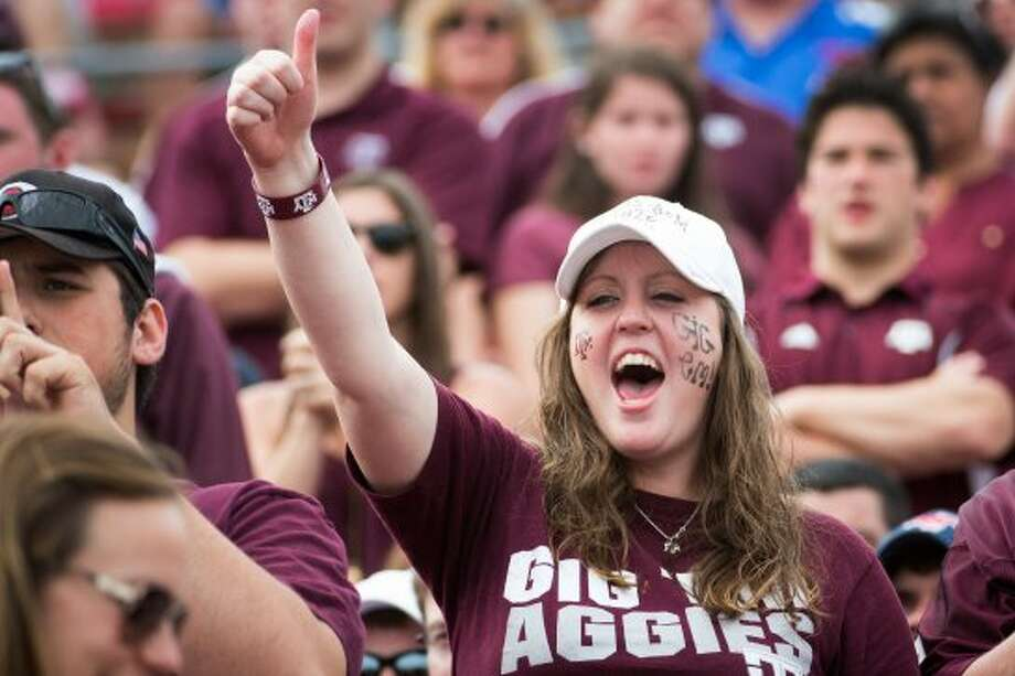 Texas A&M fans cheer their team against Southern Methodist during the second half of an NCAA football game at Ford Stadium, Saturday, Sept. 15, 2012, in Dallas.  Texas A&M won the game 48-3.( Smiley N. Pool / Houston Chronicle ) (Houston Chronicle)