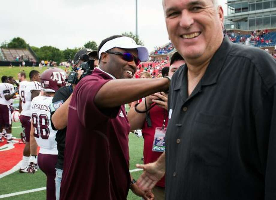 Texas A&M head coach Kevin Sumlin, left, shakes hands with Southern Methodist head coach June Jones  following the Aggies  48-3 victory in an NCAA football game at Ford Stadium, Saturday, Sept. 15, 2012, in Dallas. ( Smiley N. Pool / Houston Chronicle ) (Houston Chronicle)